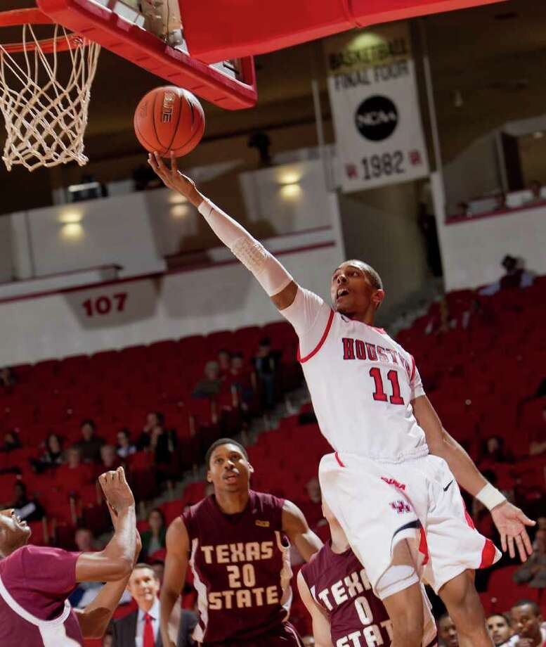 Houston's Darian Thibodeaux (11)drives to the basket baseline with a finger roll during the second half of an NCAA basketball game between Houston and Texas State Friday, December 30, 2011 in Houston. Houston defeated Texas State 94-71. Photo: Bob Levey, Houston Chronicle / ©2011 Bob Levey