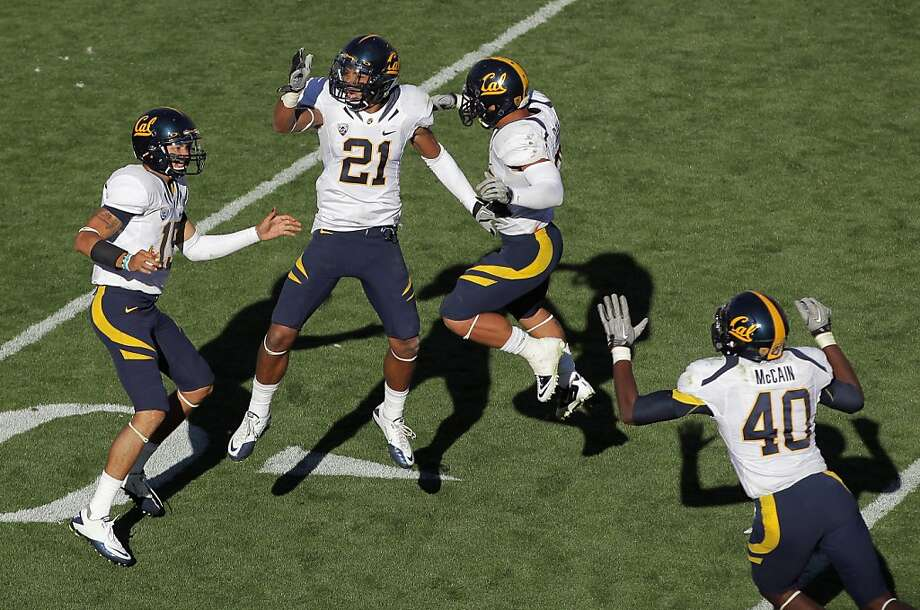 (L-R) Zach Maynard #15, Keenan Allen #21, Isi Sofele #20 and Chris McCain #40 of the California Golden Bears celebrate their 36-33 overtime victory over the Colorado Buffaloes at Folsom Field on September 10, 2011 in Boulder, Colorado. Photo: Doug Pensinger, Getty Images