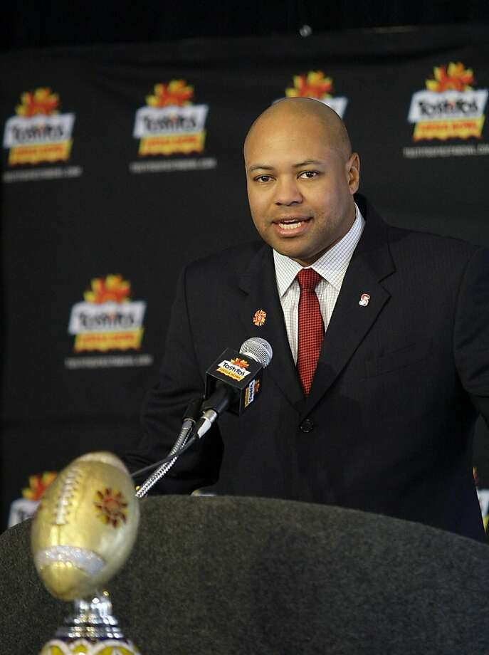 Stanford coach David Shaw answers reporters' questions during a news conference upon arrival to play Oklahoma State in the Fiesta Bowl college football game Monday, Dec. 26, 2011at Sky Harbor International Airport in Phoenix. (AP Photo/Paul Connors) Photo: Paul Connors, Associated Press