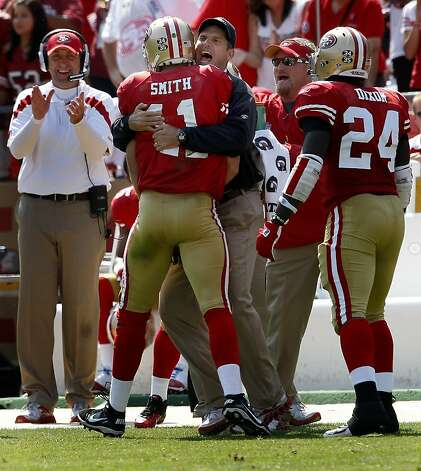 San Francisco 49ers head coach Jim Harbaugh welcomes Alex Smith back to the sideline after his second quarter touchdown against the Seattle Seahawks at Candlestick Park on Sunday, Sep. 11, 2011. Photo: Brant Ward, The Chronicle