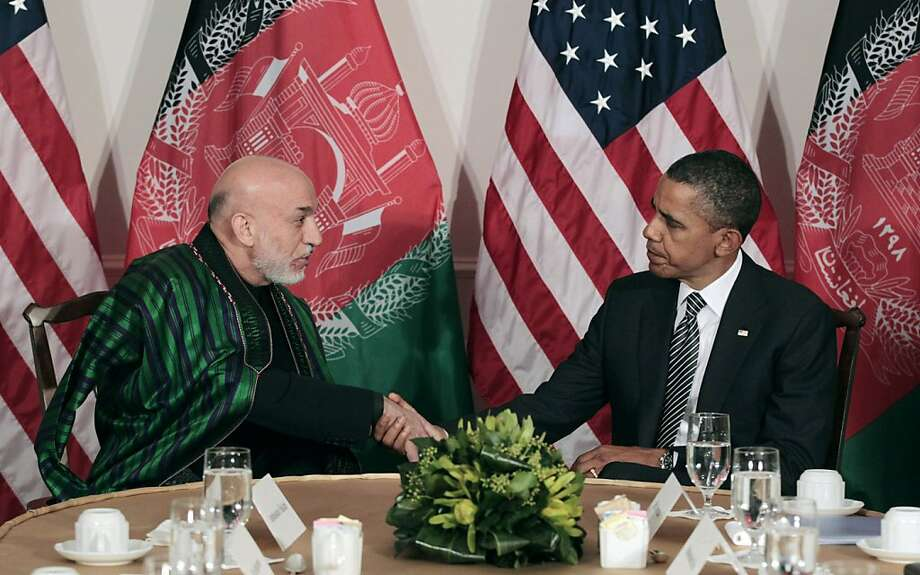 FILE - In this Sept. 20, 2011 file photo, President Barack Obama meets with Afghan President Hamid Karzai in New York. The Obama administration hopes to restore momentum in the spring to U.S. talks with the Taliban insurgency that had reached a critical point before falling apart this month because of objections from Afghan President Hamid Karzai, U.S. and Afghan officials said.   (AP Photo/Pablo Martinez Monsivais, File) Photo: Pablo Martinez Monsivais, Associated Press