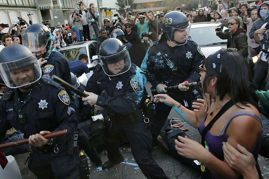 Officers take up a position on Washington and Eighth streets and push back the Occupy Oakland protesters Tuesday. Photo: Michael Macor, The Chronicle