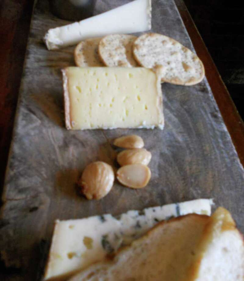 Cheese is an easy -- and popular -- way to feed guests at a holiday party. Photo: Patti Woods / Fairfield Citizen contributed