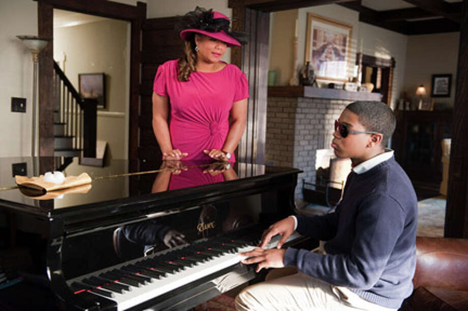 "Queen Latifah as Vi Rose Hill and Dexter Darden as Walter Hill in ""Joyful Noise."" Photo: Van Redin / ©2011 Alcon Film Fund, LLC"