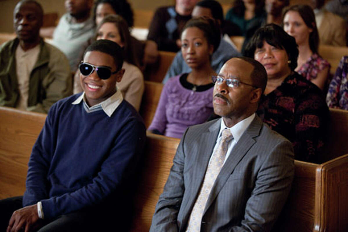 (L-R) Dexter Darden as Walter Hill and Courtney B. Vance as Pastor Dale in