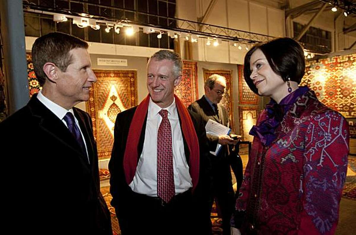 John Buchanan, Director of the Fine Arts Museums of San Francisco, talks with Malcolm Warner and Lucy Buchanan(left to right) at the Tribal and Textile Arts Show at Fort Mason in San Francisco, Calif., on Thursday, February 11, 2009.