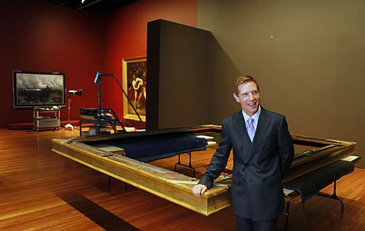 """John Buchanan stands next to General Prim frame as he explains how transport priceless painting and how sometimes they are removed from their frames for shipment. The De Young Museum will unveil it's newsiest show May 22nd """"Birth of Impressionism: with over one hundred masterpieces from the Musee d'Orsay in Paris. One of the more famous is Whistlers Mother by James McNeill Whistler painted in 1871.Wednesday May 5, 2010"""