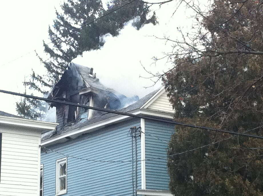 Fire damages a Cuyler Avenue home in Albany. (Will Waldron / Times Union)