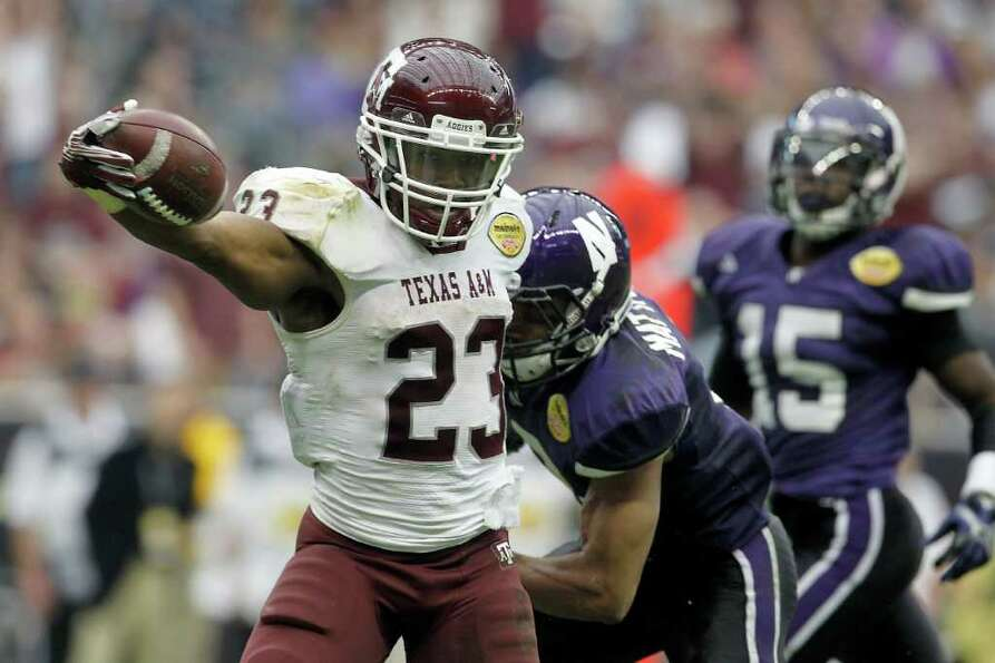Texas A&M Aggies running back Ben Malena (23) reacts as he crosses the goal line for a touchdown aga