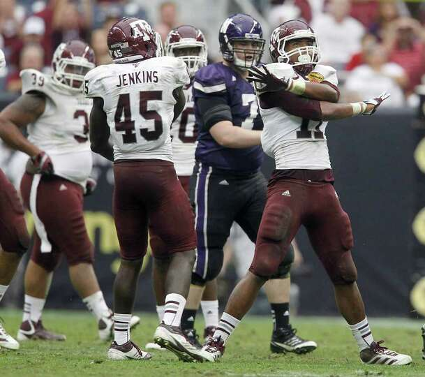 Texas A&M Aggies linebacker Jonathan Stewart (11) signals fourth down for Northwestern during the fo