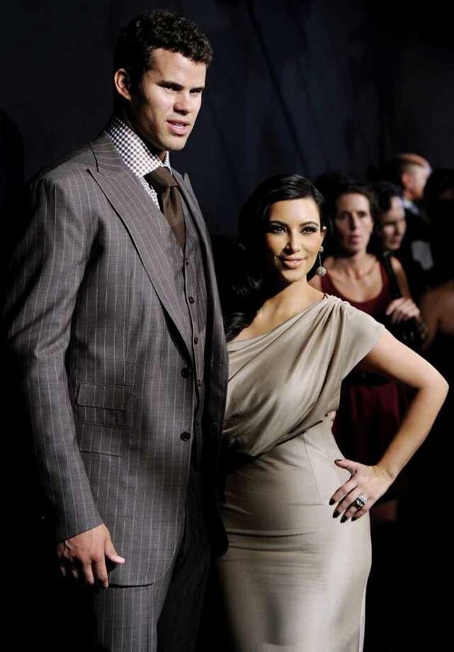 Kim Kardashian and former hubby Kris Humphries, pictured in Aug. 2011 in New York City, are just two of the celebrities spotted in and around Greenwich in 2011. (AP Photo/Evan Agostini, file) Photo: Evan Agostini, Associated Press / AP2011