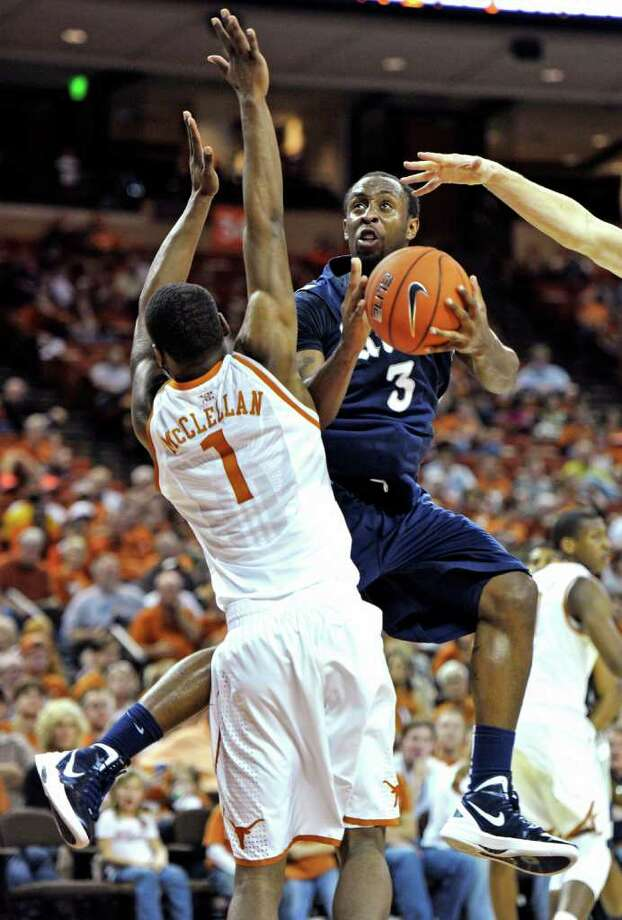 Rice guard Tamir Jackson (3) looks to shoot against Texas guard Sheldon McClellan (1) during the second half of an NCAA college basketball game, Saturday, Dec. 31, 2011, in Austin, Texas. Texas won 73-59. (AP Photo/Michael Thomas) Photo: Michael Thomas / FR65778 AP
