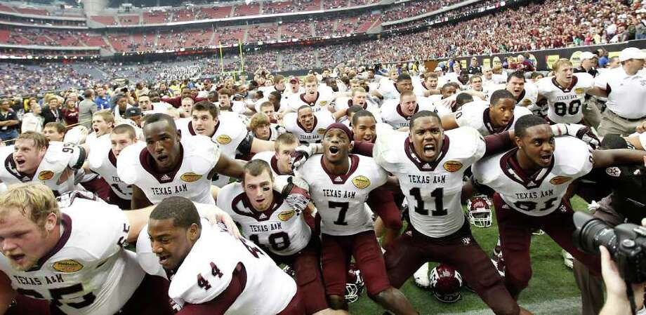 Texas A&M Aggies players celebrate after the Meineke Car Care Bowl at Reliant Stadium,Saturday, Dec. 31, 2011, in Houston.  Texas A&M won the game against Northwestern University 33-22. Photo: Karen Warren, Houston Chronicle / © 2011 Houston Chronicle