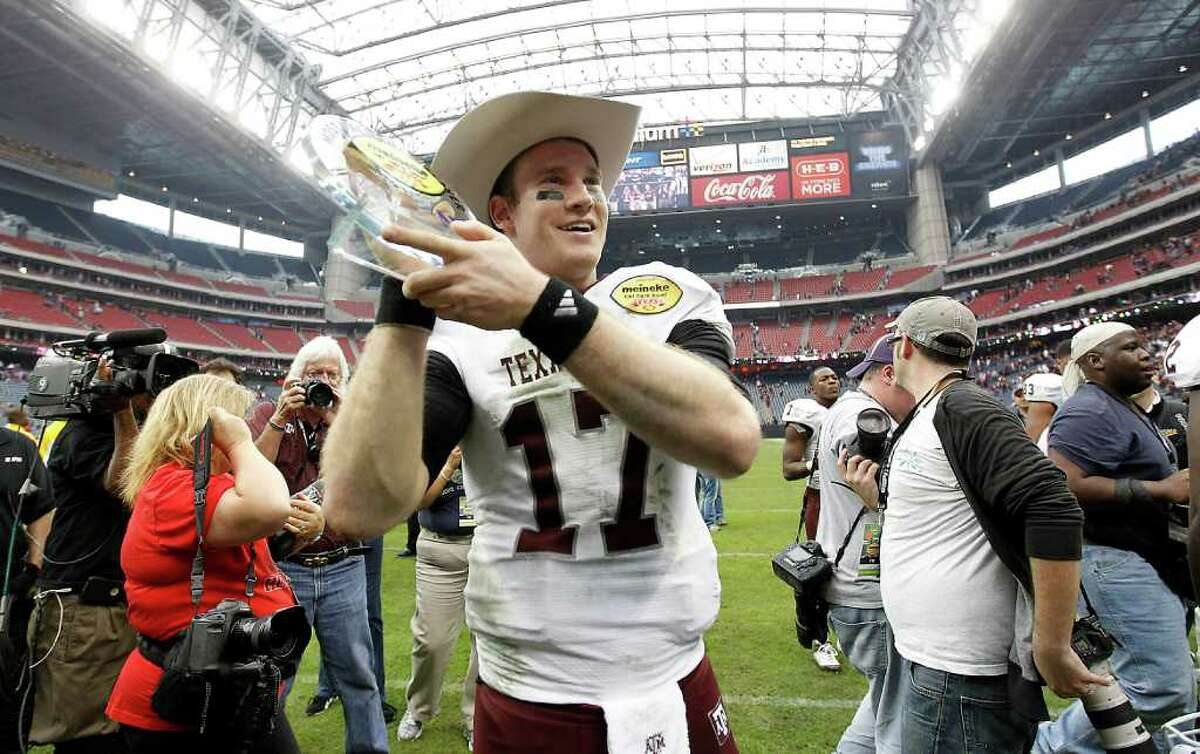 Texas A&M Aggies quarterback Ryan Tannehill (17) who was named MVP holds his trophy and wears his cowboy hat after the Meineke Car Care Bowl at Reliant Stadium,Saturday, Dec. 31, 2011, in Houston. Texas A&M won the game against Northwestern University 33-22.