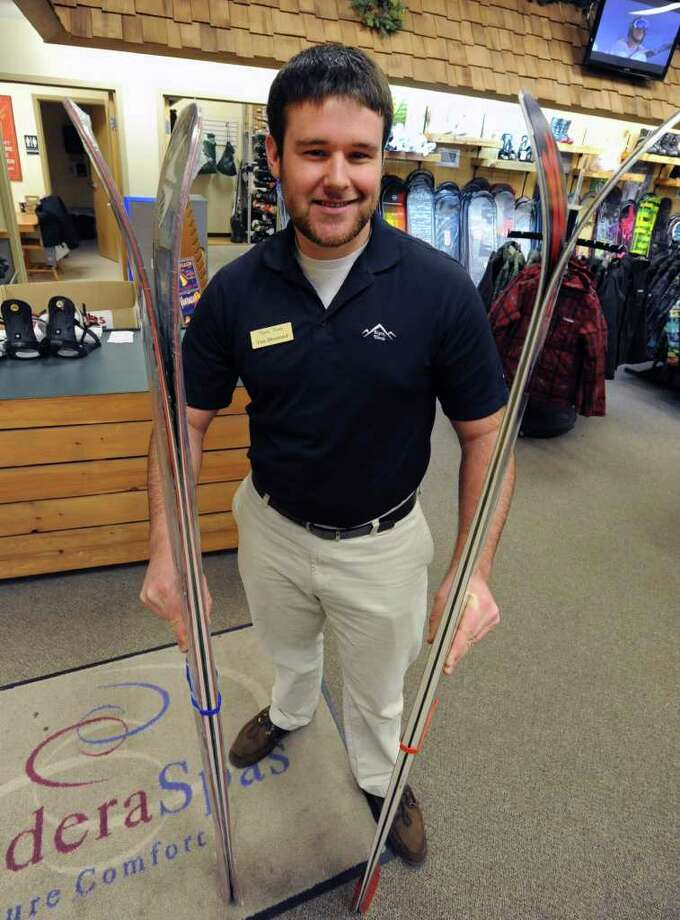 Alpin Haus employee Tim Diamond holds the Bizzard Bonafide which is the new rockered style ski on the left and Volkl Mantra which is an older style ski on the right at the Alpin Haus store Wednesday, Dec. 28, 2011 in Clifton Park, N.Y. The rockered style ski has a longer curve toward the tip of the ski than the older style ski. (Lori Van Buren / Times Union) Photo: Lori Van Buren