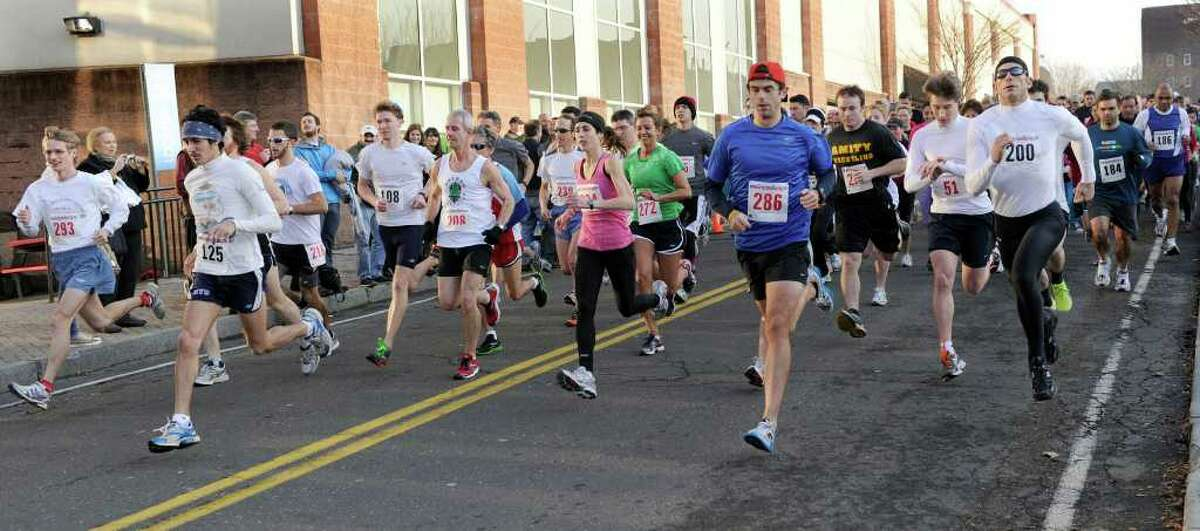 First Night Danbury activities kicks off Saturday afternoon with a 5K road race that started on Delay Street. Photo taken Saturday, Dec. 31, 2011.