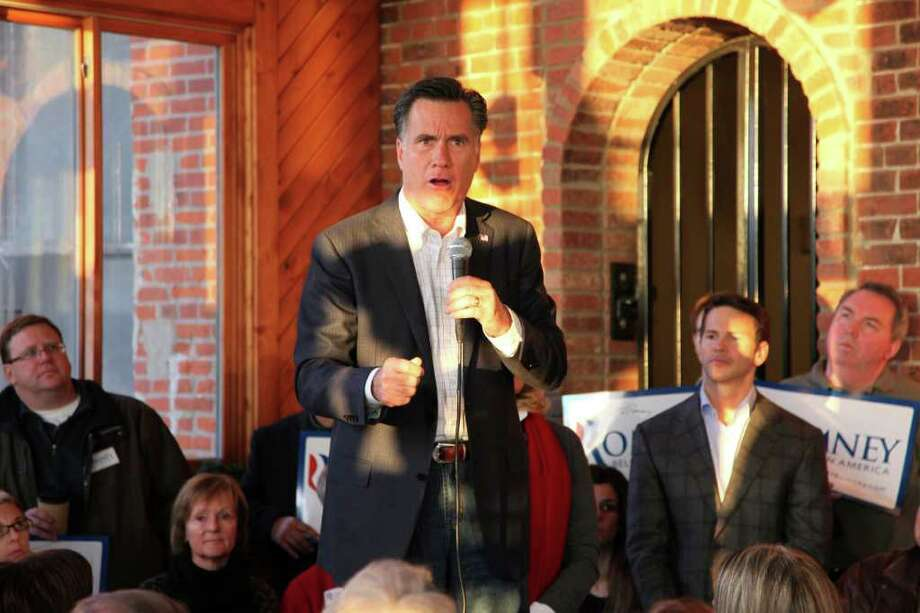 This frame grab from video shows Republican presidential candidate, former Massachusetts Gov. Mitt Romney speaking during a campaign stop at Elly's Tea and Coffee in Muscatine, Iowa, Wednesday, Dec. 28, 2011.  (AP Photo/Robert Ray) Photo: Robert Ray / AP