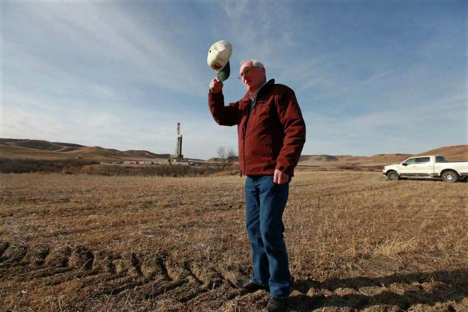 NICOLE BENGIVENO : NEW YORK TIMES LOOKED AHEAD: Fred Evans visits one of his oil wells, where his bet on mineral rights made him wealthy, in Stanley, N.D., Photo: NICOLE BENGIVENO / NYTNS