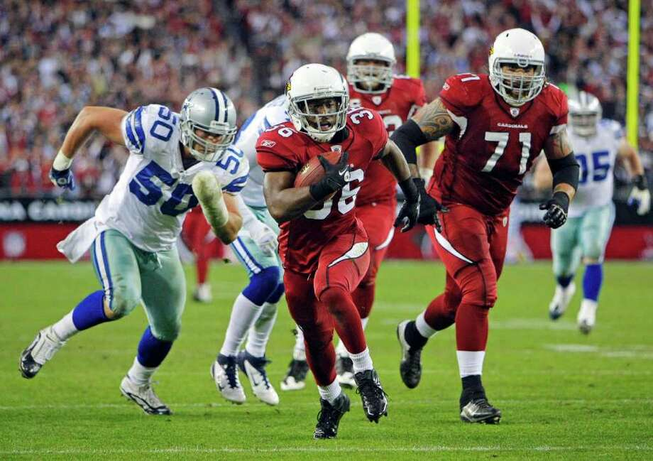Arizona Cardinals running back LaRod Stephens-Howling (36) turns a short pass from quarterback Kevin Kolb into a 52-yard game-winning touchdown run during overtime of an NFL football game against the Dallas Cowboys, Sunday, Dec. 4, 2011, in Glendale, Ariz. The Cardinals won 19-13. (AP Photo/The Arizona Republic, David Kadlubowski)  MARICOPA COUNTY OUT; MAGS OUT; NO SALES Photo: AP