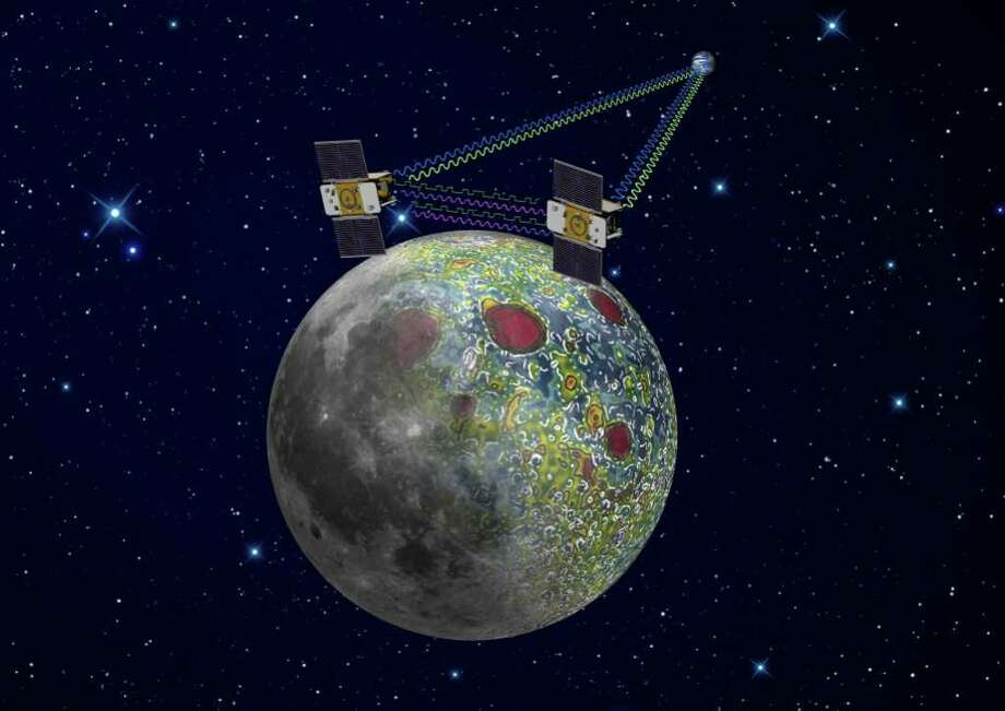 NASA via ASSOCIATED PRESS MAPPING: This artist's rendering provided by NASA shows the twin GRAIL spacecraft mapping the moon's gravity field. The two probes are scheduled to enter orbit this weekend. / NASA/JPL