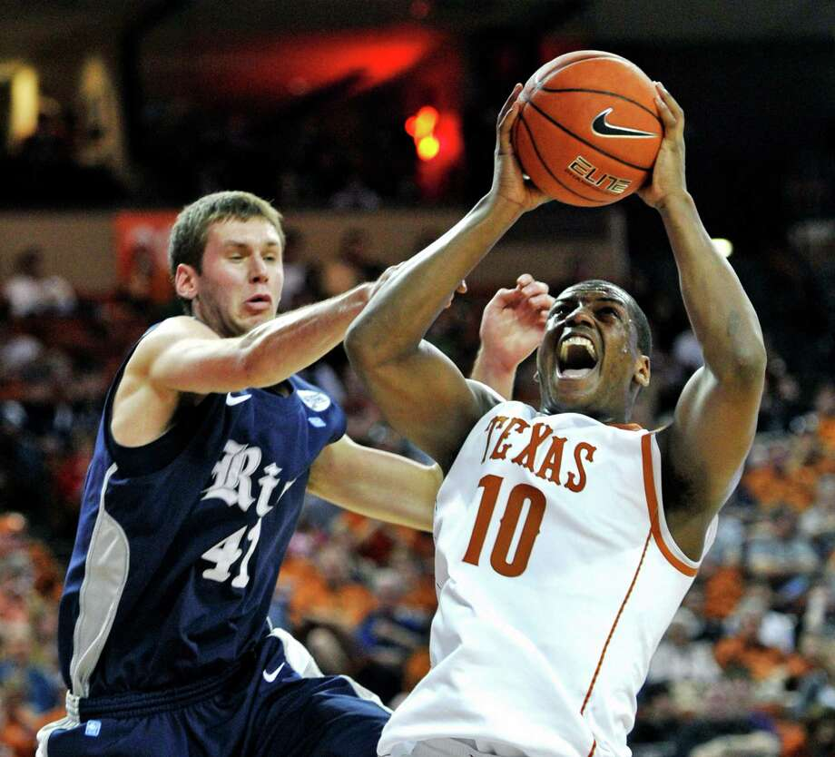 Texas guard Jonathan Holmes (10) shoots against Rice forward Seth Gearhart during the second half of an NCAA college basketball game, Saturday, Dec. 31, 2011, in Austin. Texas won 73-59. Photo: Michael Thomas, Associated Press / FR65778 AP