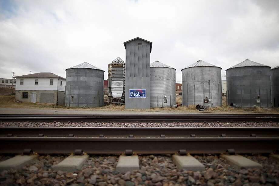 A sign for Republican presidential candidate, former Massachusetts Gov. Mitt Romney is seen on a grain bin in Woodbine, Iowa, Friday, Dec. 30, 2011. (AP Photo/Charles Dharapak) Photo: Charles Dharapak, Associated Press