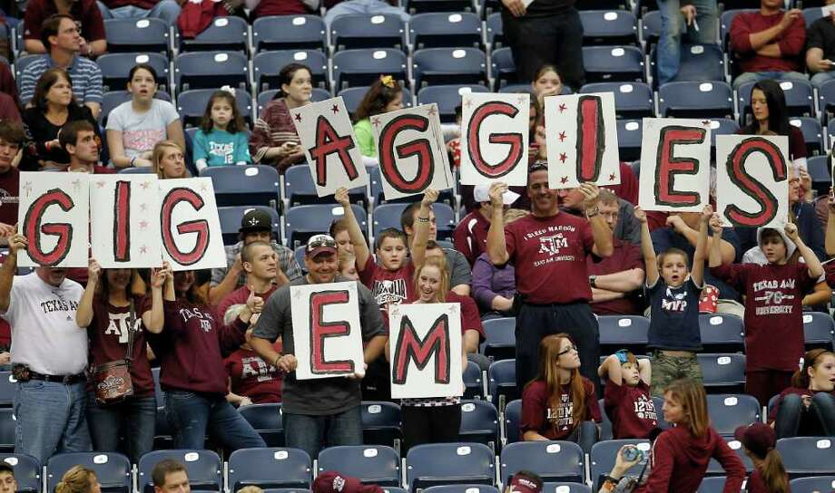 A&M fans show their pride for the team before the start  of the Meineke Car Care Bowl at Reliant Stadium last December. Photo: Karen Warren, Houston Chronicle / © 2011 Houston Chronicle