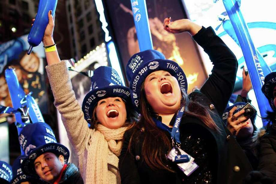 Revelers cheer on Times Square. Photo: John Minchillo, Associated Press / AP