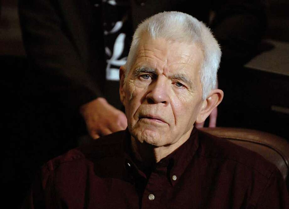 "Donald Miles, the brother-in-law and ""father figure"" of David Bacon, who gave a victim impact statement to the court on behalf of the family, listens to DA James Murphy talk during a press conference after the sentencing of Nelson Costello in Ballston Spa, NY on January 15, 2010.  Nelson Costello who admitted in October that he killed a romantic rival 40 years ago was sentenced to a maximum of 17 years in state prison today.  (Lori Van Buren / Times Union) Photo: LORI VAN BUREN / 00007060A"