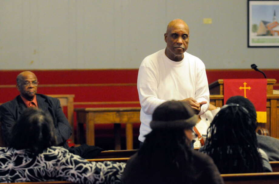 The Rev. Edward B. Smart speaks during a community meeting to discuss the shooting death of Nahcream Moore by the Albany Police at the St. John's Church of God in Christ in Albany on Saturday, Dec.31, 2011. ( Michael P. Farrell/Times Union)