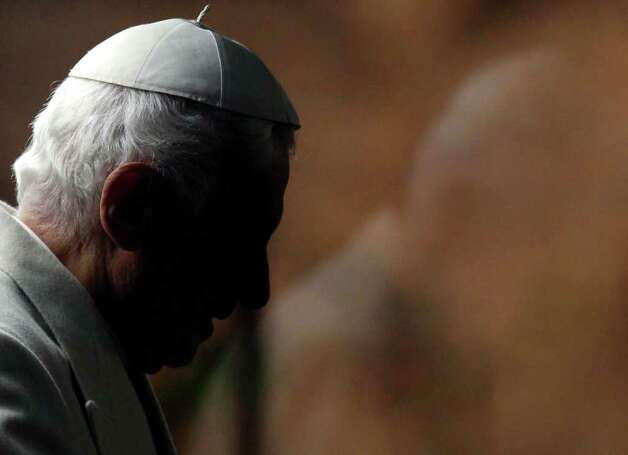 "Pope Benedict XVI arrives in St. Peter's square to visit the nativity scene at the Vatican, Saturday, Dec. 31, 2011. The Pontiff marked the end of 2011 with prayers of thanks and said humanity awaits the new year with apprehension but also with hope for a better future. ""Another year approaches its end, while we await a new one, with the trepidation, desires and expectations of always,"" Benedict said at the traditional New Year's Eve vespers service, as he delivered his homily from the central altar of St. Peter's Basilica on Saturday evening. (AP Photo / Pier Paolo Cito) Photo: Pier Paolo Cito / AP"