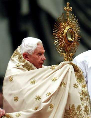 "Pope Benedict XVI holds the ostensory as he celebrates a New Year's Eve vespers service in St. Peter's Basilica at the Vatican, Saturday, Dec. 31, 2011. The Pontiff marked the end of 2011 with prayers of thanks and said humanity awaits the new year with apprehension but also with hope for a better future. ""Another year approaches its end, while we await a new one, with the trepidation, desires and expectations of always,"" Benedict said at the traditional New Year's Eve vespers service, as he delivered his homily from the central altar of St. Peter's Basilica on Saturday evening. (AP Photo/Pier Paolo Cito) Photo: Pier Paolo Cito / AP"