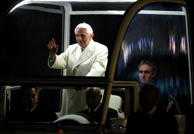 "Pope Benedict XVI blesses the faithful as he arrives in St. Peter's square to bless the nativity scene at the Vatican, Saturday, Dec. 31, 2011. The Pontiff marked the end of 2011 with prayers of thanks and said humanity awaits the new year with apprehension but also with hope for a better future. ""Another year approaches its end, while we await a new one, with the trepidation, desires and expectations of always,"" Benedict said at the traditional New Year's Eve vespers service, as he delivered his homily from the central altar of St. Peter's Basilica on Saturday evening. (AP Photo/Pier Paolo Cito) Photo: Pier Paolo Cito / AP"