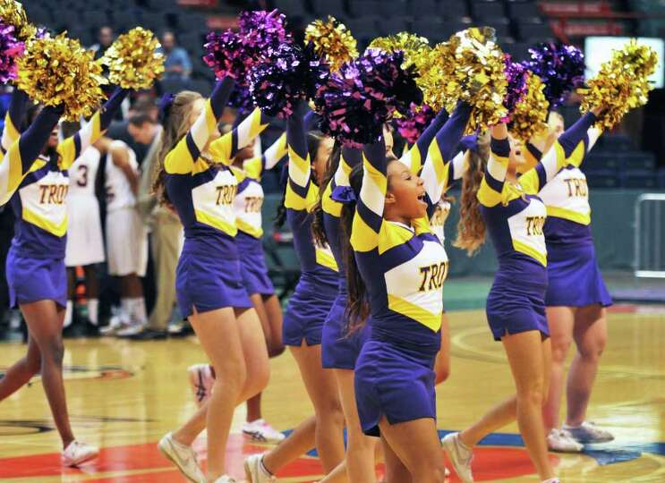 Troy cheerleaers perform during a time out against Henniger High Saturday at the  Times Union Center
