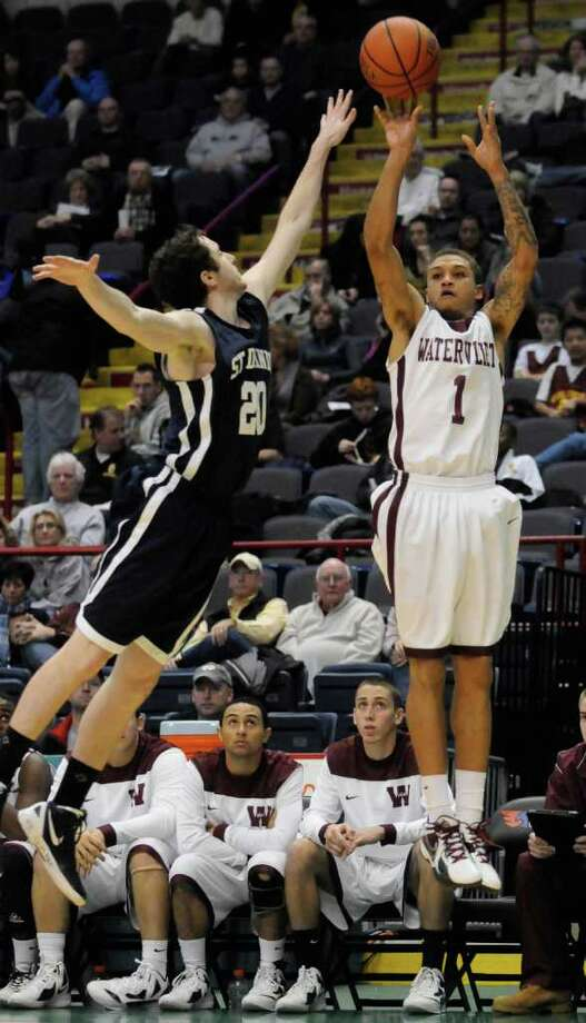 Watervliet's Jordan Gleason shoots a jumper over St.Dominics Tim Divietri during their high school basketball game in the Holiday Hoops HS Classic at the Times Union Center in Albany,NY Saturday, Dec.31, 2011. ( Michael P. Farrell/Times Union) Photo: Michael P. Farrell