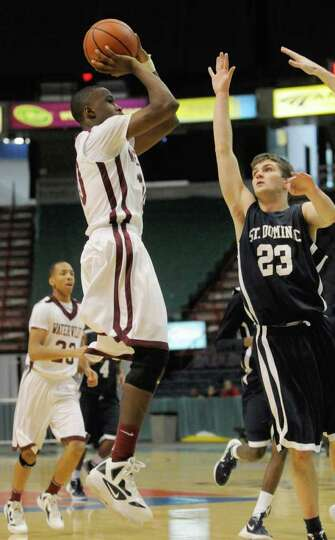 Watervliet's Tyler McLeod takes a shot during their high school basketball game against St. Dominics