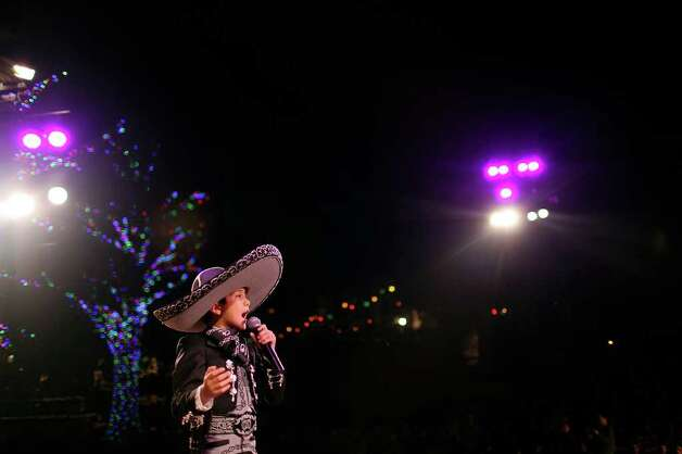 Sebastian De La Cruz, 9, performs at the Arneson River Theatre during the Celebrate San Antonio event held Saturday Dec. 31, 2011.  Photo: EDWARD A. ORNELAS, SAN ANTONIO EXPRESS-NEWS / SAN ANTONIO EXPRESS-NEWS (NFS)