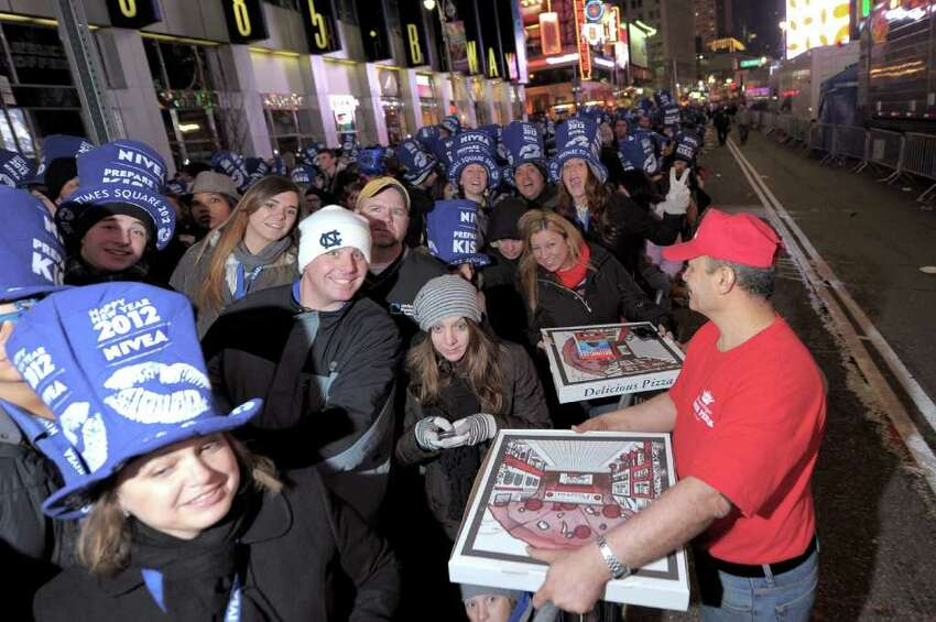 NEW YORK, NY - DECEMBER 31: Crowds Gather For New Year's Ball Drop In Times Square on December 31, 2011 in New York City. (Photo by Michael Loccisano/Getty Images)