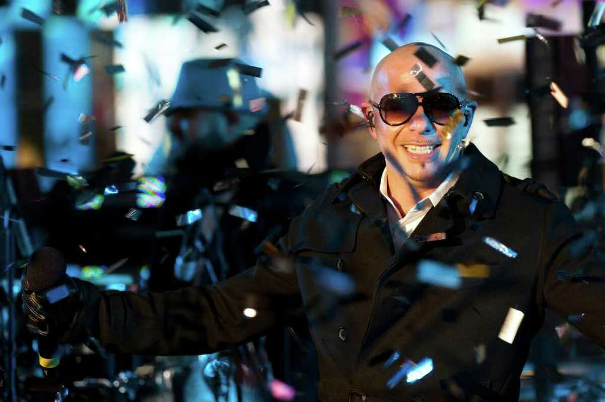 Pitbull performs in Times Square during New Year's Eve celebrations, Saturday, Dec. 31, 2011, in New York. (AP Photo/Charles Sykes)