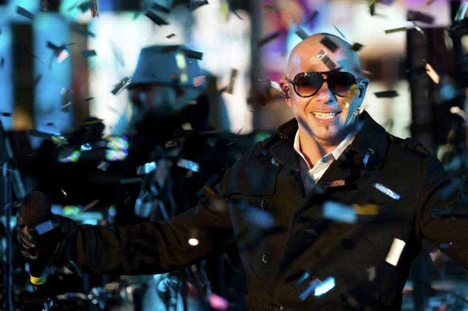 Pitbull performs in Times Square during New Year's Eve celebrations, Saturday, Dec. 31, 2011, in New York. (AP Photo/Charles Sykes) Photo: Charles Sykes, ASSOCIATED PRESS / Associated Press
