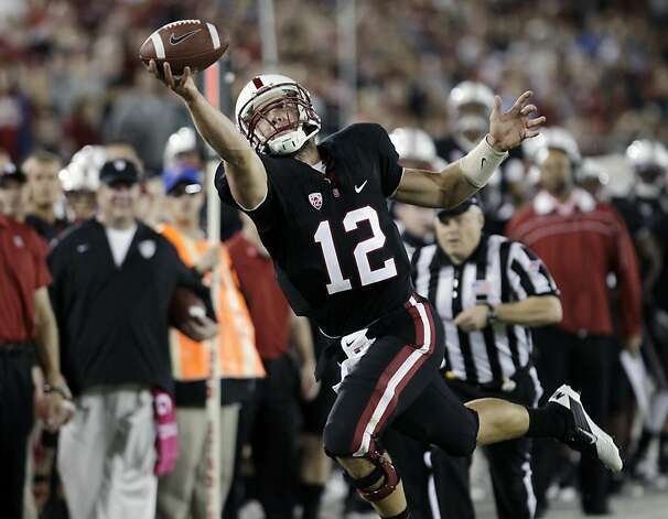 FILE - In this Oct. 1, 2011 file photo, Stanford quarterback Andrew Luck (12) catches a pass near the end zone against UCLA of an NCAA college football game, in Stanford, Calif. Luck is a finalist for the Heisman Award. (AP Photo/Paul Sakuma, file) Photo: Paul Sakuma, Associated Press