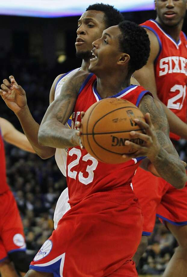 Philadelphia 76ers' Lou Williams (23) drives for the basket past Golden State Warriors' Ish Smith during the first half of an NBA basketball game, Saturday, Dec. 31, 2011 in Oakland, Calif. (AP Photo/George Nikitin) Photo: George Nikitin, Associated Press