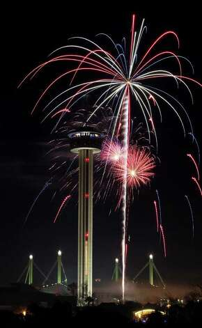 Fireworks explode around the Tower of the Americas during the Celebrate San Antonio event Sunday Jan. 1, 2012.  Photo: EDWARD A. ORNELAS, SAN ANTONIO EXPRESS-NEWS / SAN ANTONIO EXPRESS-NEWS (NFS)