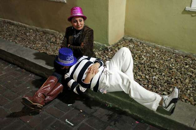 Adela Gomez (left) relaxes with her son Abel Gomez, 10, during the Celebrate San Antonio event held Saturday Dec. 31, 2011.  Photo: EDWARD A. ORNELAS, SAN ANTONIO EXPRESS-NEWS / SAN ANTONIO EXPRESS-NEWS (NFS)