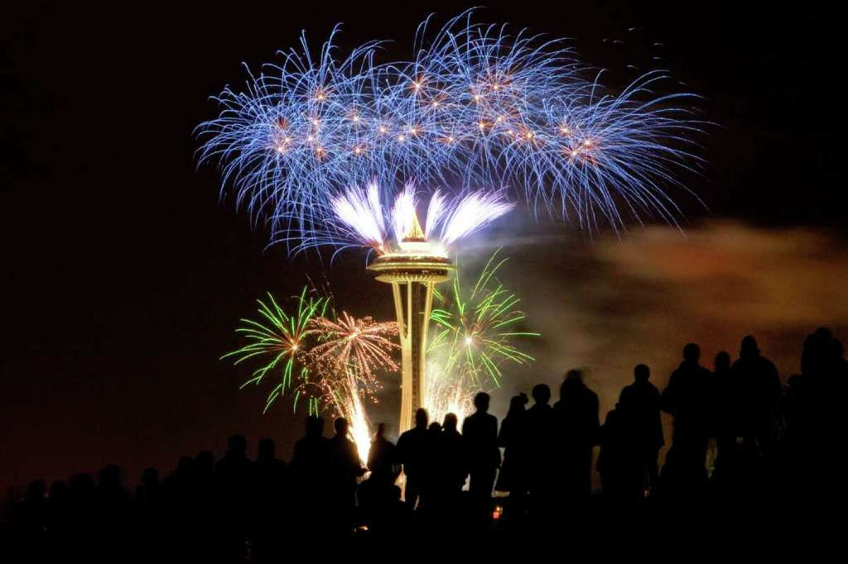 Fireworks light up the iconic Space Needle on Sunday, January 1, 2011 as Seattle rings in the New Year.