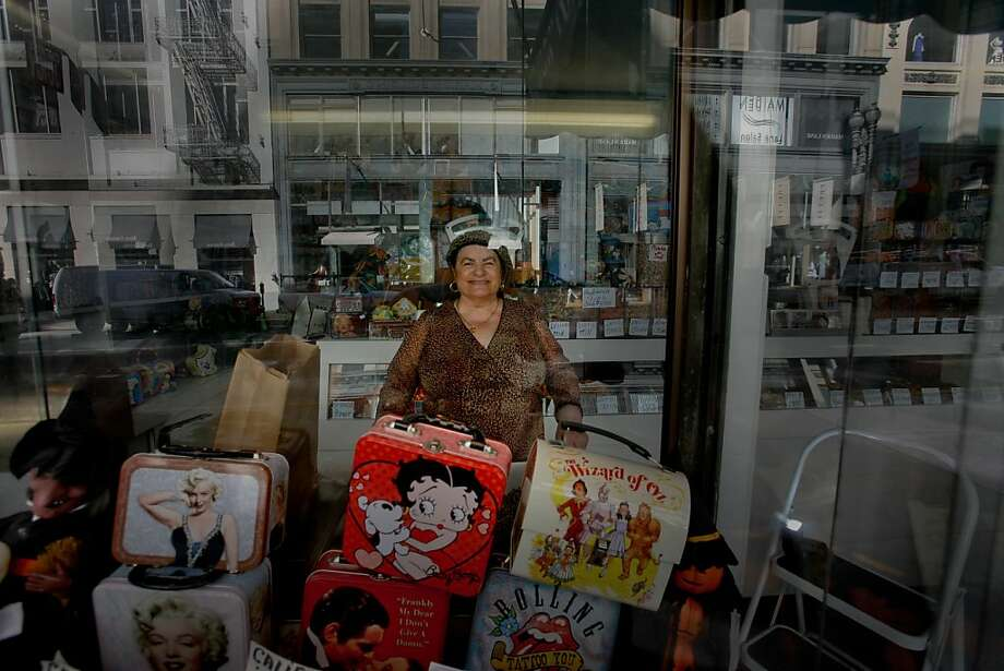 In 2008, shortly before retiring and closing the shops doors forever, Morrow's Nut House manager, Jackie Helbert keeps watch of the Geary Street store front she helmed for 37 years. Photo: Mike Kepka, The Chronicle