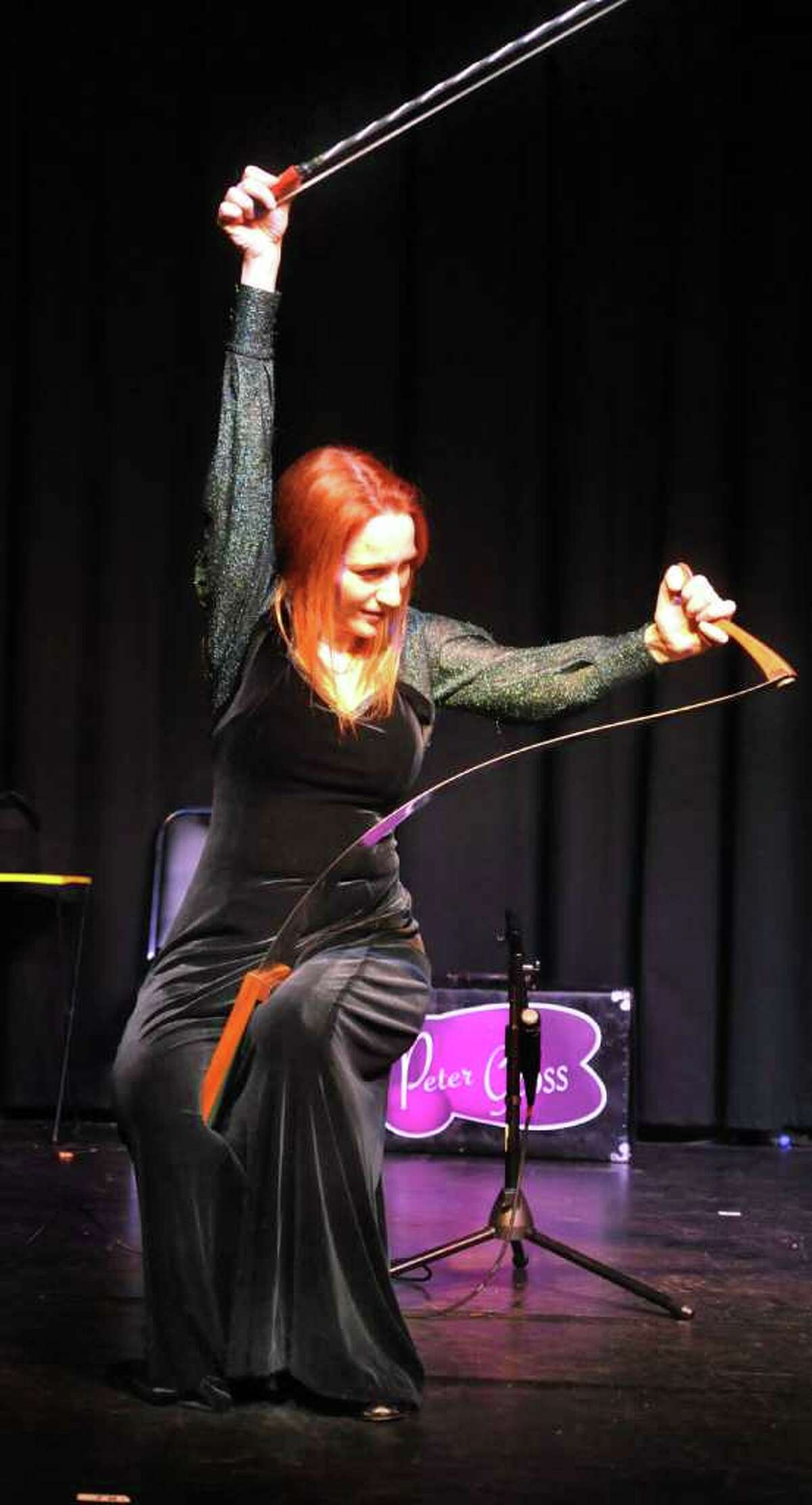 """Natalia Paruz, """"The Saw Lady,'' plays her musical saw during First Night Danbury, at the Palace Theatre Saturday, Dec. 31, 2011."""