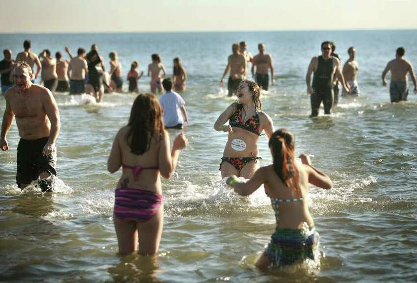 Participants brave the frigid waters of the Sound for the annual Polar Plunge at Compo Beach in Westport on Sunday, January 1, 2012. The event raised money for The Hole in the Wall Gang Camp.