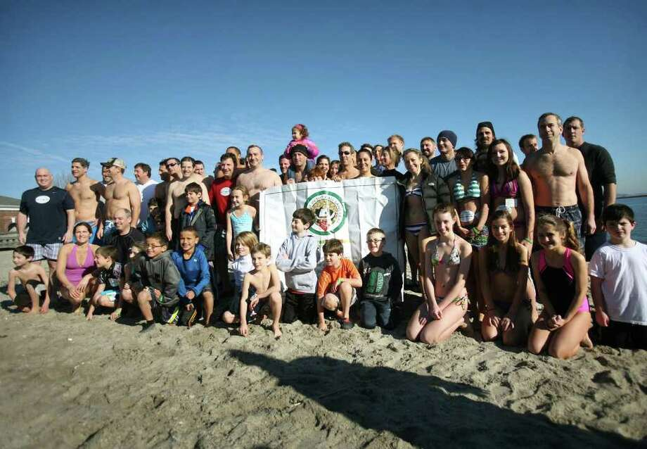 Participants pose for a group photo before the fifth annual Polar Plunge at Compo Beach in Westport on Sunday, January 1, 2012. The event raised money for The Hole in the Wall Gang Camp. Photo: Brian A. Pounds / Connecticut Post