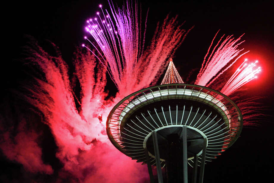 Fireworks light up the iconic Space Needle on Sunday, January 1, 2012 as Seattle rings in the New Year. / SEATTLEPI.COM
